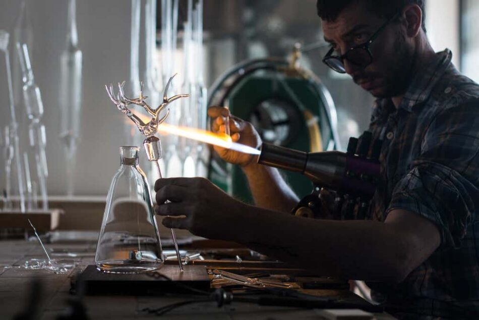 Simone Crestani works on his Trophy bottle set in his Camisano Vincenzo, Italy, atelier