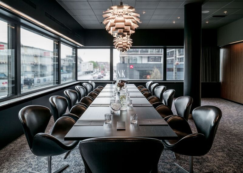 The Swan boardroom of the Radisson Blu Royal Hotel in Copenhagen with Arne Jacobsen's Swan chairs