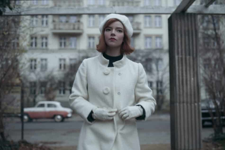 The long white coat and pom-pom beret in this ensemble are intentionally meant to mimic the queen chess piece.