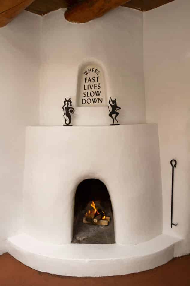 On the fireplace mantle at El Rey Court are Mermaid and Bull figures.