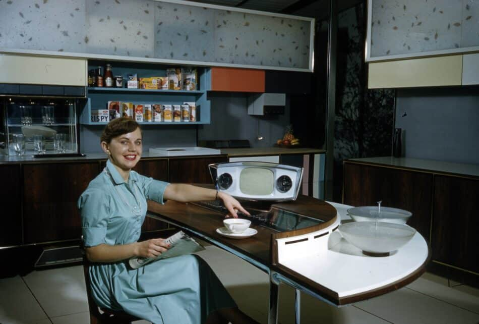 """Ann Anderson at the command center of the RCA Whirlpool """"Miracle Kitchen"""" during a demonstration at the American National Exhibition in Moscow, 1959."""