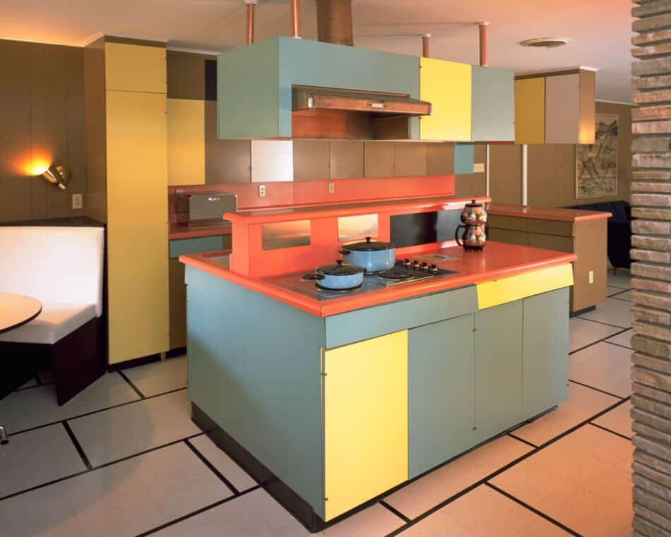 Color-blocked laminated cabinets and countertops fill the kitchen of the Historic Wilson House, in Temple, Texas.