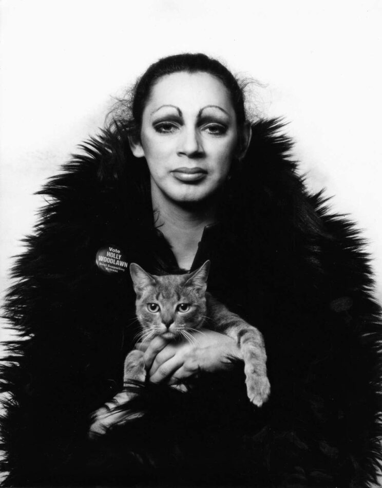 Warhol superstar Holly Woodlawn holding Nik, Mitchell's studio cat, 1971