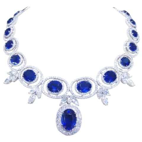 A sapphire and diamond necklace — featuring a 57-carat central pendant — set in 18 karat gold. Offered by Diamond Scene.