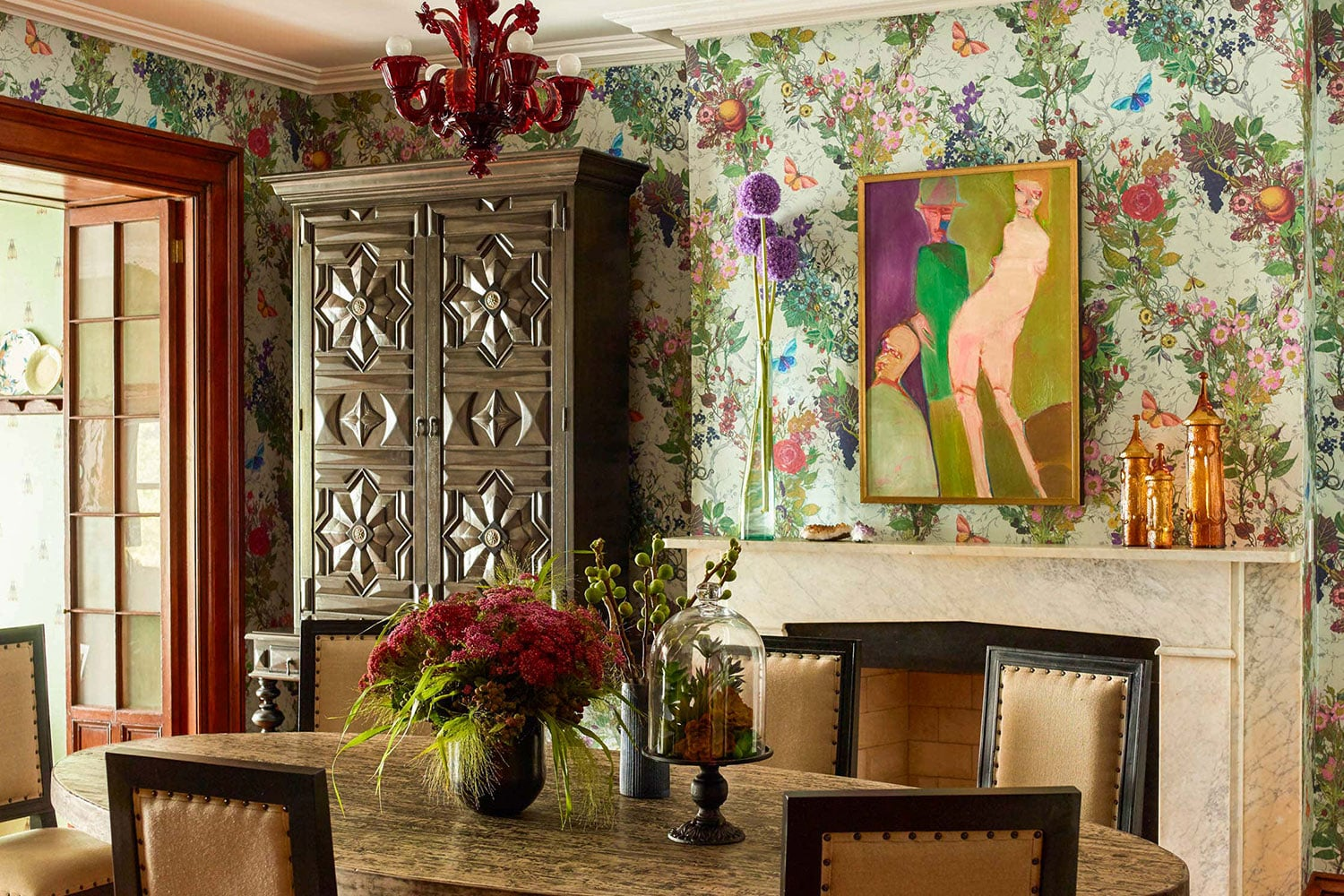 Victorian townhouse dining room with floral chintz wallpaper
