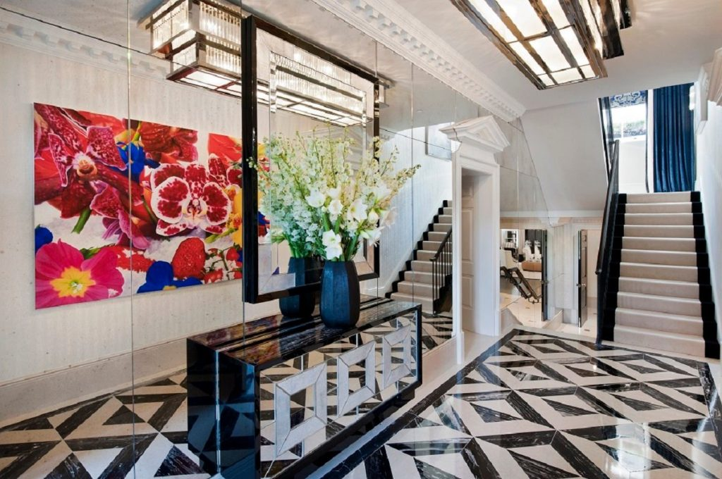 London entry hall by Argent Design with a graphic black and white floor