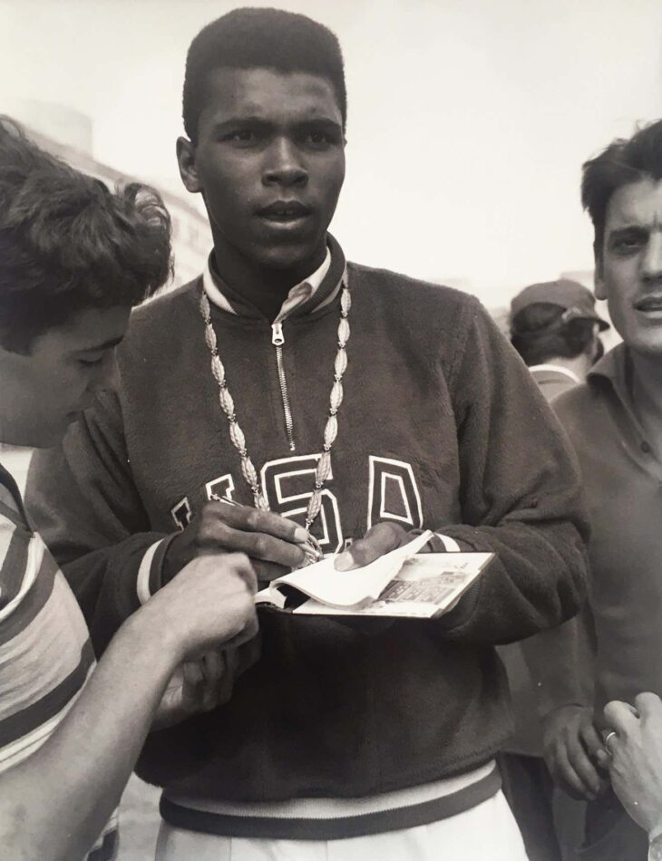 Print of Muhammad Ali at the XVII Rome Olympics wearing a USA pullover