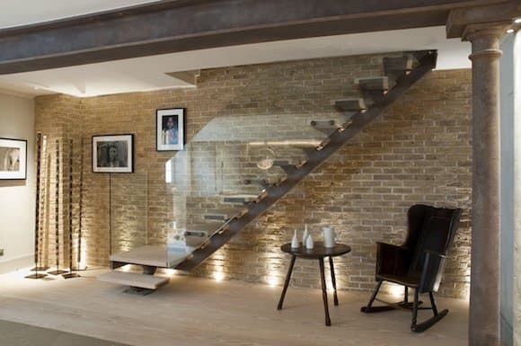 Tea can be taken under the stairs in this London townhouse by Riviere Interiors.