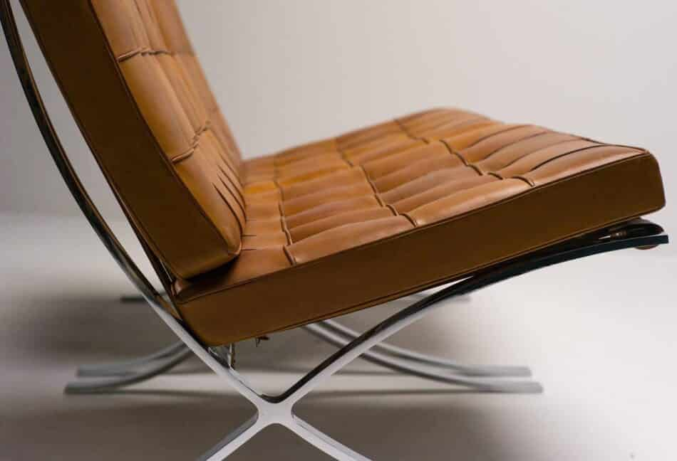 Detail of a Barcelona chair in cognac leather