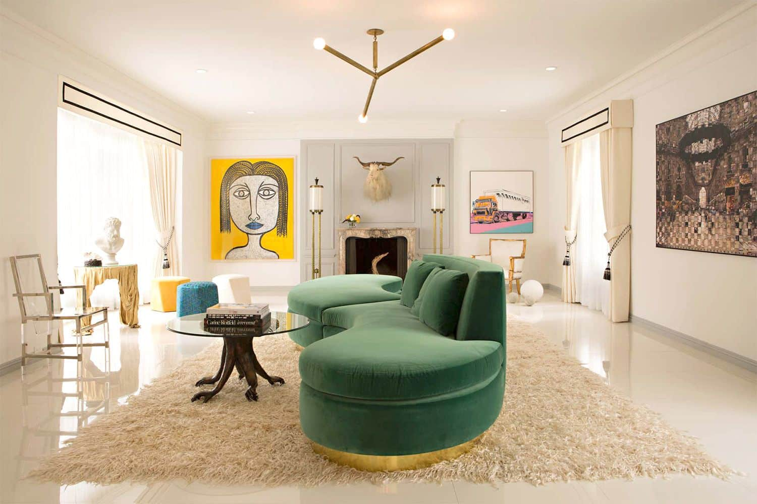 Image of a living room with a green couch and a colored artwork on the walls