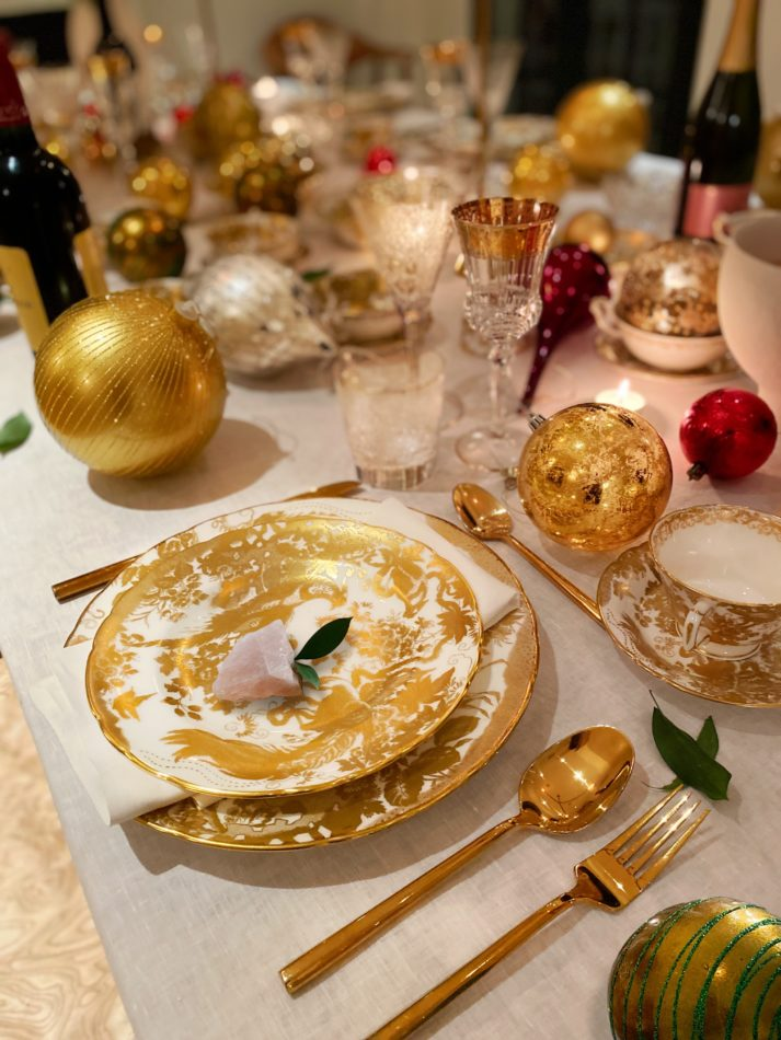 A golden place setting in Brigette Romanek's holiday tablescape