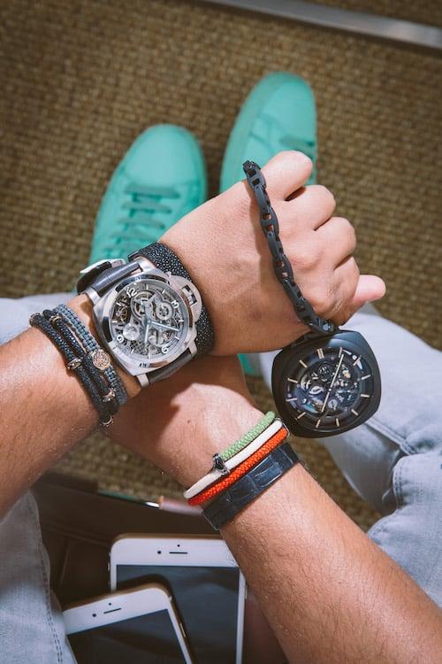 For a statement-making off-duty look, Bhatt wears colorful kicks and an oversize Panerai Lo Scienziato Luminor 1950 Tourbillon GMT Titanio. He's also holding a ceramic Panerai Pocket Watch Tourbillon GMT Ceramica.