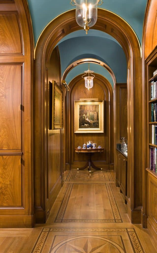 In this Peter Pennoyer–designed home in Dutchess County, New York, the library has wood-paneled walls and flooring.