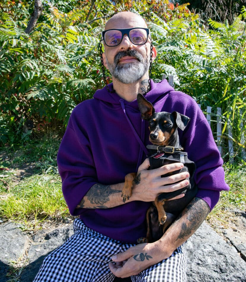 Queer|Art board president Nelson Santos with his dog, Timmy.