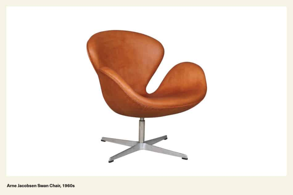 A light brown leather chair with silver legs