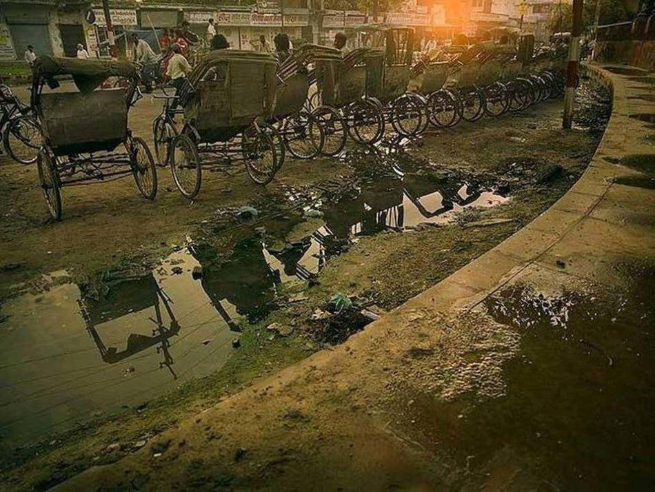 Street Scene Varanasi, 2007, by Andreas H. Bitesnich