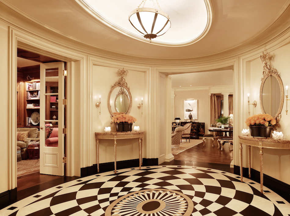 Belgian marble flooring lines the oval foyer of a San Francisco home designed by Tucker & Marks and architect Andrew Skurman.